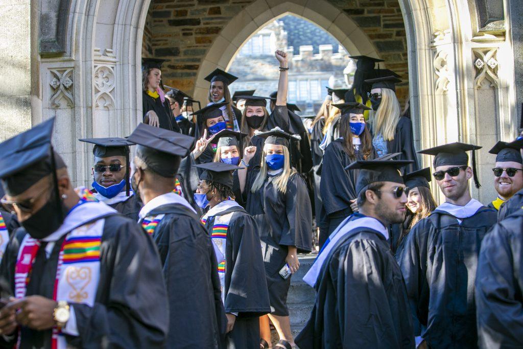 Graduates enter Abele Residential Quad for the ceremony